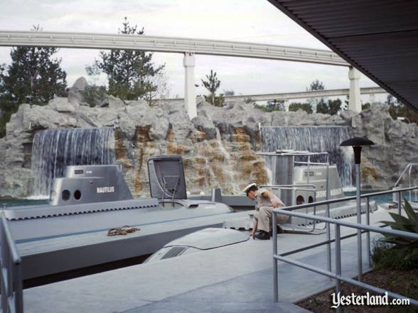 Photograph of the Submarine Voyage cast member opening the hatch