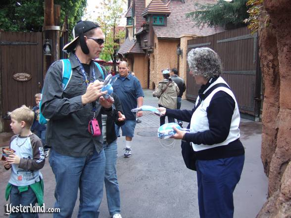 "A Dream Squad cast member dispenses ""dream"" ears to park guests"