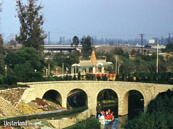 Photo of Fantasyland Depot behind Storybookland Canal Boats