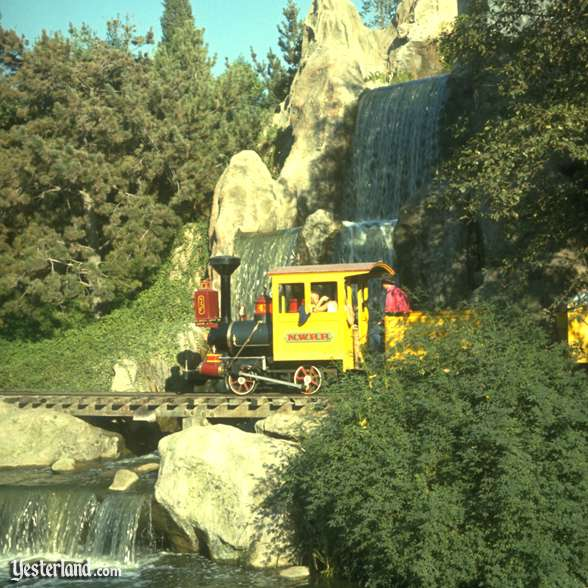 Photo of train and waterfalls