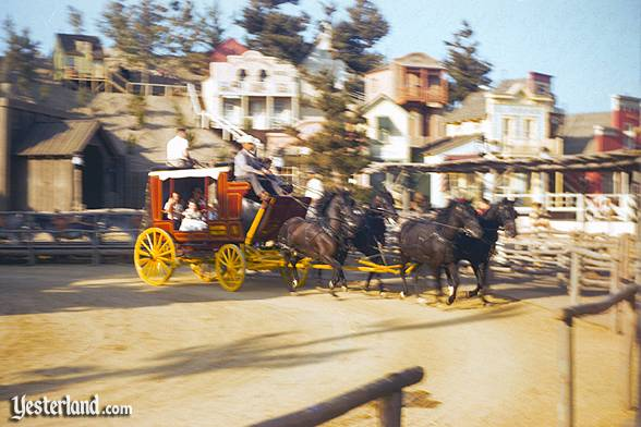Four horses pulling the Stagecoach Ride into Rainbow Ridge