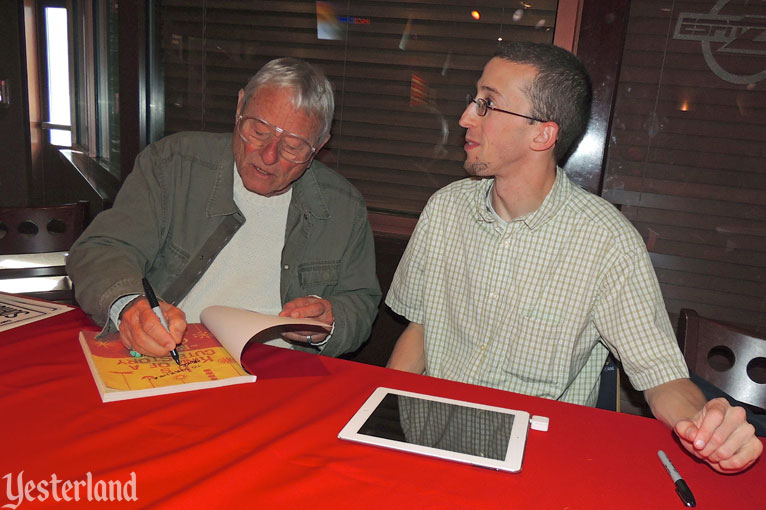 Rolly Crump signing copies of It's Kind of a Cute Story