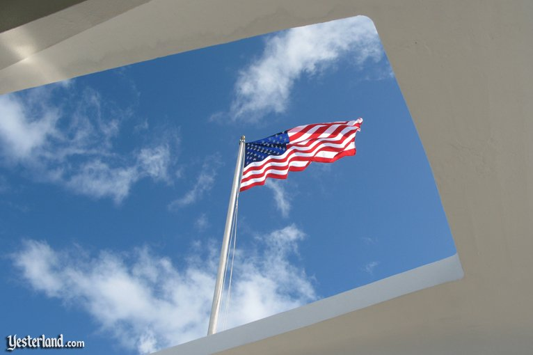 Stars and Stripes flying above the USS Arizona Memorial
